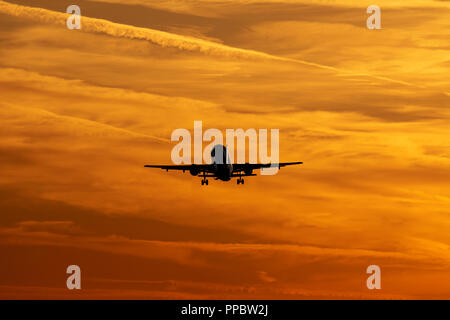 Luton Airport, London, UK. 24th Sep 2018. UK Weather: A silhouette of on Airbus A320 taking off at sunset Credit: Nick Whittle/Alamy Live News - Stock Photo