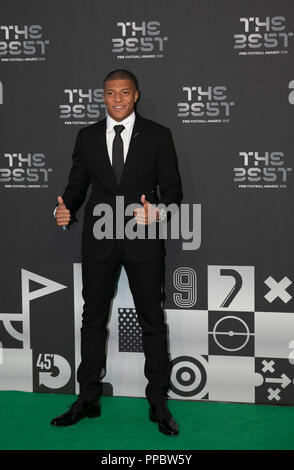 London, UK. 24th Sep, 2018. Kylian Mbappe arrives on the Green Carpet ahead of the Best FIFA Football Awards 2018 in London, Britain on Sept. 24, 2018. Credit: Han Yan/Xinhua/Alamy Live News - Stock Photo