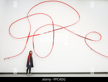 London, UK, 25th Sep 2018. A gallery assistant poses with Monika Sosnowska's 'Handrail'. Hayward Gallery's new major exhibition Space Shifters features artworks by 20 leading international artists that disrupt the visitor's sense of space and alter their perception of their surroundings. The exhibition runs 26 September  - 6 January. Credit: Imageplotter News and Sports/Alamy Live News - Stock Photo