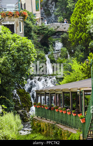 waterfall with stone bridge in the village Moustiers-Sainte-Marie, Provence, France, member of most beautiful villages of France - Stock Photo