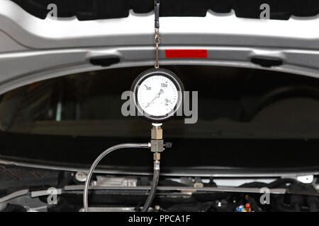 Petrol engine automotive compression test gauge service - Stock Photo