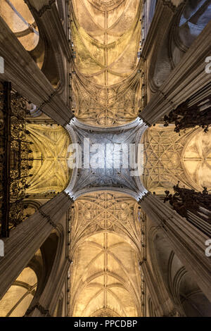 Artistic ceiling vault, Interior of the Cathedral of Seville, Catedral de Santa Maria de la Sede, Seville, Andalusia, Spain - Stock Photo
