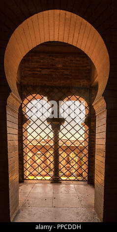 Window and archway, belfry La Giralda of the Cathedral of Seville, Catedral de Santa Maria de la Sede, Seville, Andalusia, Spain - Stock Photo
