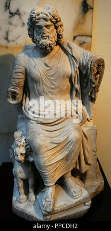 Roman statue of God Serapis. 2nd century AD. Marble. Probably, small copy of a statue by Bryaxis for the Temple of Serapis in Alexandria. Museum of Mediterranean and Near Eastern Antiquities. Stockholm. Sweden. - Stock Photo