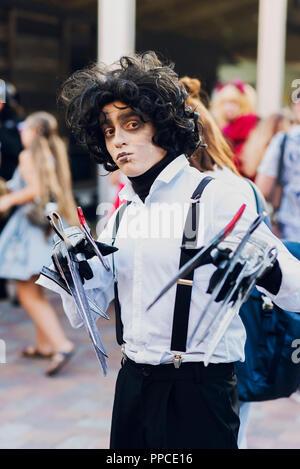 September 22, 2018 Kiev, Ukraine, Art Plant Platform. festival of modern pop culture COMIC CON. Guy in the costume character Tim Burton hands scissors - Stock Photo