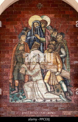 Stations of the Cross:Jesus is helped by Cireneu; A panel of Portuguese tiles outside the shrine of Fatima - Stock Photo