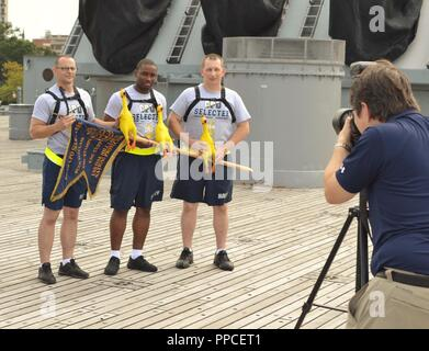 CPO Selectees from the USS Carter Hall (LSD-50) pose for their group picture with their rubber chickens aboard the USS Wisconsin (BB-64). Photographing the CPO Selectees is HR Naval Museum's historian, Clay Farrington. After group pictures, they competed for the title of the Best Mess during a cadence and guidon competition during the 18th Annual CPO Heritage Days. This annual event is hosted by the Hampton Roads Naval Museum, in conjunction with local Chief Petty Officers and Nauticus. This year's event was held on August 21-23, 2018, and attracted over 840 CPO selectees from 58 area and out  - Stock Photo