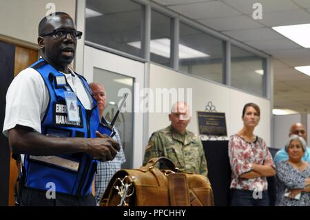 Carlton Bray, Anti-terrorism Officer, U.S. Army Medical Command Provost Marshal Office, conducts the after action discussion following an active shooter drill on August 29, 2018, at the U.S. Army Health Contracting Activity on Joint Base San Antonio. - Stock Photo