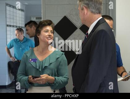 Dr. Angela Hemingway, the executive director of the Idaho STEM Action Center, speaks with Lt. Gov. Brad Little, lieutenant governor for the state of Idaho, before the grand opening ceremony of Starbase Idaho at Gowen Field, Boise, Idaho on Aug. 31, 2018. Starbase is a Department of Defense program designed to motivate students, primarily socio-economically disadvantaged fifth graders, to explore more education in science, technology, and math areas of study. - Stock Photo