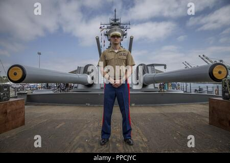 U.S. Marine Corps Maj. Scott Sasser, a media operations officer with I Marine Expeditionary Force, poses for a photo following his promotion ceremony where he was promoted from Captain to Major aboard the USS Iowa during Los Angeles Fleet Week, Sept. 1, 2018. The residents of San Pedro, Calif., were invited to view the promotion as Sasser was promoted from a company-grade officer to a field-grade officer. Commissioned officer ranks are subdivided into generals, field-grade, and company-grade officers. Through fleet weeks, the military gains the opportunity to educate area leaders and the gener - Stock Photo