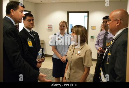 """KING GEORGE, Va. (Aug. 29, 2018) – James Smerchansky, Dr. Luis Rodriguez, Air Force Maj. Amanda Clark, Navy Vice Adm. Raquel Bono, Ray Cho, and John Fiore, left to right, discuss diversity at the first Leadership in a Diverse Environment Conference hosted by Naval Surface Warfare Center Dahlgren Division(NSWCDD). Smerchansky - Naval Sea Systems Command (NAVSEA) executive director - spoke to participants about diversity and inclusion. Bono – director of the Defense Health Agency – briefed on how to """"Lead Where You Are to Inspire, Engage, and Innovate"""". Fiore - NSWCDD technical director – kicked - Stock Photo"""