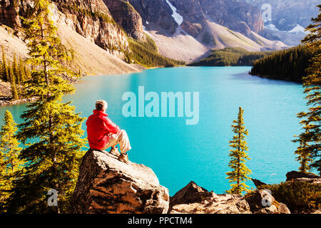 Moraine Lake in the Canadian Rockies is one of the most picturesque, beautiful places in the whole of the Rocky mountains. The green/blue colour of the water is caused by rock flour, from glaciers reflecting diffrent colour wavelengths. - Stock Photo