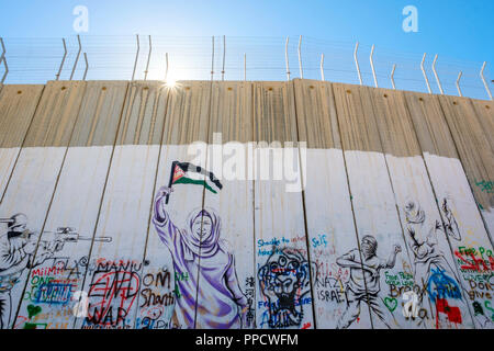 Portion of the Israeli West Bank Barrier wall covered in graffiti, Bethlehem, West Bank, Palestine - Stock Photo