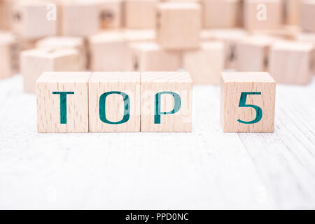 The Words Top 5 Formed By Wooden Blocks On A White Table - Stock Photo