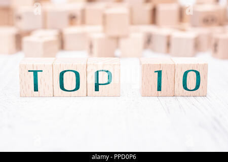 The Words Top 10 Formed By Wooden Blocks On A White Table - Stock Photo