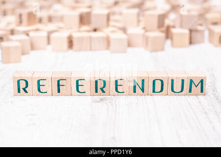The Word Referendum Formed By Wooden Blocks On A White Table - Stock Photo