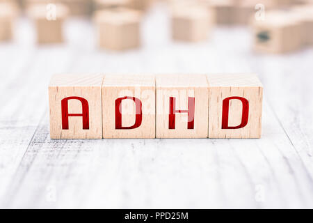 The Abbreviation ADHD Formed By Wooden Blocks On A White Table - Stock Photo