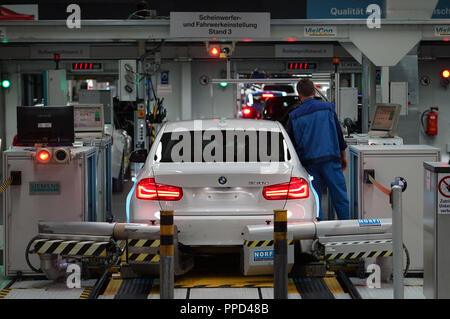 Automobile production at the BMW parent plant in Milbertshofen. In the picture, the headlight and suspension settings for a BMW 3 Series. - Stock Photo