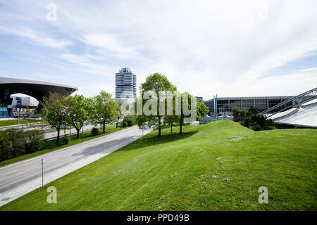 Buildings on the Mittlerer Ring in the north of Munich: on the left the facade of the BMW Welt, next the headquarters of the automobile manufacturer, on the right the Olympia-Eissporthalle. - Stock Photo