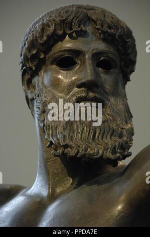 Greek art. Classical period. Initial Period. Zeus. Bronze sculpture. Dated to the year 460 BCE Found at sea from Cape Artemision. Severe Style. Detail of the head. National Archaeological Museum. Athens. Greece. - Stock Photo