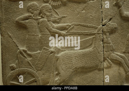 Relief depicting a lion's hunt. 750 BC. Basalt. Detail. From the Palace of Sakcegozu, Anatolia. Pergamon Museum. Berlin. Germany. - Stock Photo