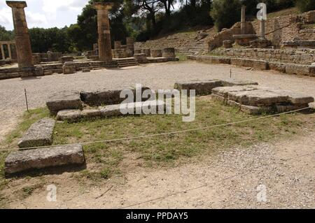 Olympia. Temple of Hera. It was built aound 600 BC. View of the altar. The torch of the Olympic flame is lit in its ruins since 1936. Elis region, Peloponnese, Greece. - Stock Photo