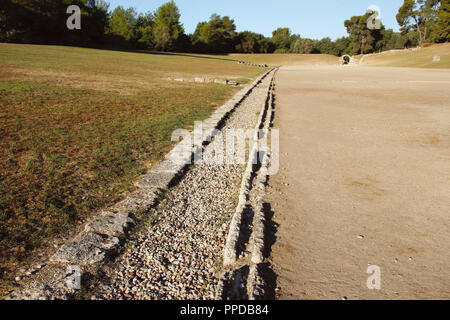 Greek Art. Sanctuary of Olympia. Panorama of the ancient Olympic Stadium. Detail of the water channel. The east of archaelogical site.  Elis. Peloponesse. Greece. Europe. - Stock Photo