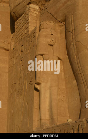 Egyptian Art. Temple of Ramses II (1290-1224 BC). Nefertari. Statue near the feet of the colossi of Ramses II. 19th dynasty. New Kingdom. Abu Simbel. Egypt. - Stock Photo