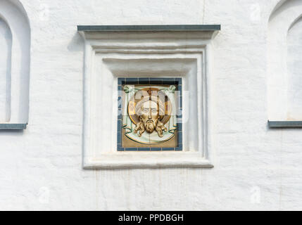 Not the big icon, encased in a white wall of the Spaso-Preobrazhensky Solovetsky monastery, Arkhangelsk oblast, Russia. - Stock Photo