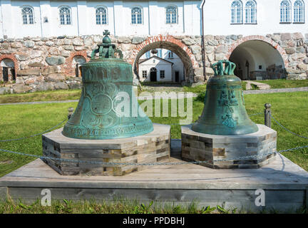 Vintage bell with traces of bullets in the courtyard of the Spaso-Preobrazhensky Solovetsky monastery, Arkhangelsk oblast, Russia. - Stock Photo