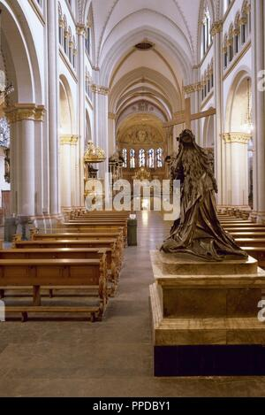 Germany. Bonn. Minster of St. Martin's. Late Romanesque architecture style. First of all, bronze statue of St. Helena, donated by Cardinal Franz Wilhelm von Wartenberg, Provost of the Collegiate Church (1629-1661). - Stock Photo