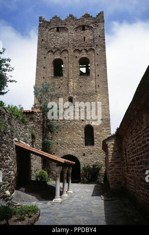France. Pyrenees-Orientales. Languedoc-Roussillon region. Abbey of Saint-Martin-du-Canigou. Monastery built in 1009, on Canigou mountain. It was built from 1005-1009 by Guifred, Count of Cerdanya in Romanesque style. View of the bell tower. Restoration of 1900-1920. - Stock Photo