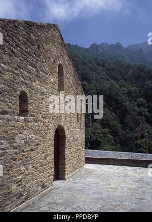 France. Pyrenees-Orientales. Languedoc-Roussillon region. Abbey of Saint-Martin-du-Canigou. Monastery built in 1009, on Canigou mountain. It was built from 1005-1009 by Guifred, Count of Cerdanya in Romanesque style. Main facade of the church. Restoration of 1900-1920. - Stock Photo