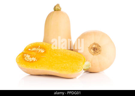 Group of two whole one half of smooth pear shaped orange butternut squash waltham variety with seeds isolated on white background - Stock Photo
