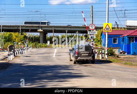 Samara, Russia - September 23, 2018: Traffic light and road sign on the railway crossing - Stock Photo