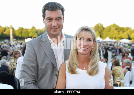 Finance Minister Markus Soeder (CSU) and his wife Karin at the summer reception of the Bavarian Landtag (State Parliament) in Schleissheim Palace. - Stock Photo