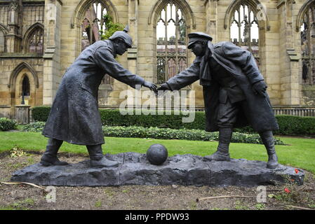 Truce by Andy Edwards. A full size bronze sculpture displayed in Memorial Garden at St. Lukes, 'The Bombed Out Church' in Liverpool, England, UK. As t - Stock Photo