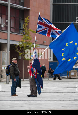 Man with a Union Jack and EU flag demonstrating against Brexit at the Labour party conference in Liverpool UK 2018. - Stock Photo