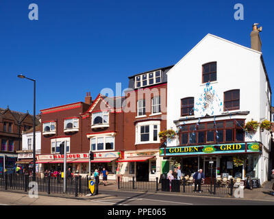 The Harbour Bar icecream parlour and Golden Grid seafood restaurant on the seafront at Scarborough North Yorkshire England - Stock Photo