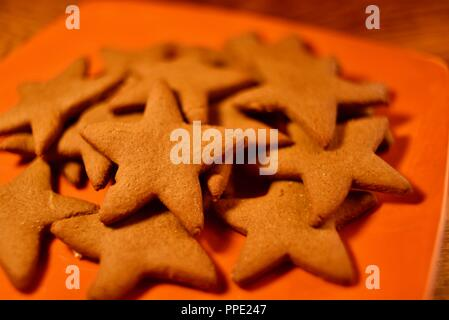 Traditional Latvian Piparkukas, gingerbread stars, homemade, home baked holiday Christmas cookies, made in Wisconsin, USA - Stock Photo