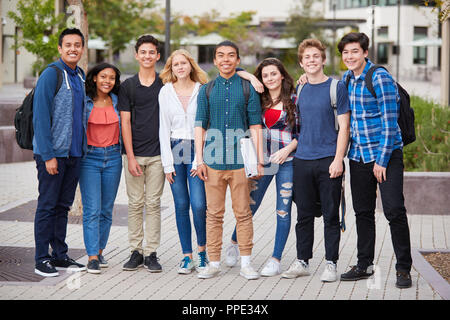 Portrait Of High School Students Outside College Buildings - Stock Photo