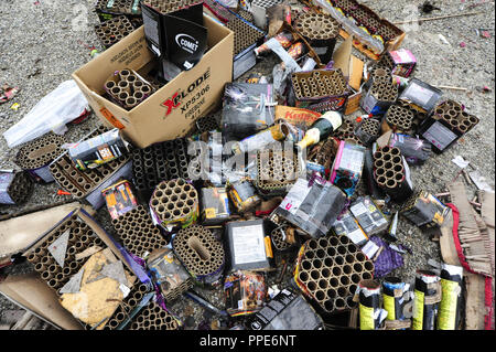Waste of exploded fireworks on the Koenigsplatz in Munich after New Year's Eve. - Stock Photo