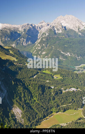 On the Kehlstein overlooking the Koenigssee and Watzmann, Berchtesgaden. Hitler got the Eagle's Nest as a present for his 50th birthday, today it is one of the most popular attractions in Berchtesgadener Land. Panoramic view of the Berchtesgaden Alps, Koenigsee, Untersberg. - Stock Photo
