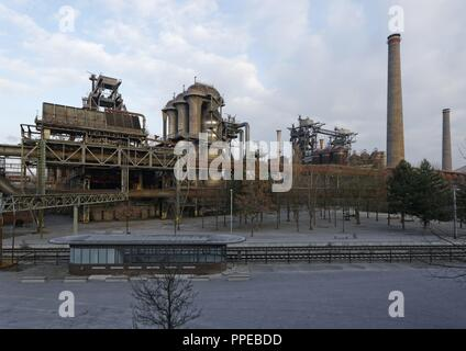 Transformation of a former ironworks and an industrial fallow to the Landscape Park Duisburg-Nord, a public park and an industrial monument, former furnaces | usage worldwide - Stock Photo