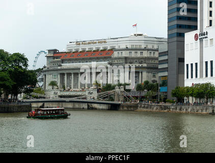 The Fullerton Hotel and Financial District Skyscrapers with Taxi River Boat and Tourists in Downtown Singapore Republic of Singapore Asia - Stock Photo