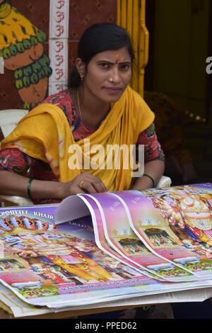 women selling calander at festival - Stock Photo