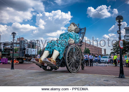 Liverpool, UK - July 24, 2014: 'Grandma' a giant Royal De Luxe street puppet in Liverpool for 'Memories of 1914' This is part of the World War I center - Stock Photo