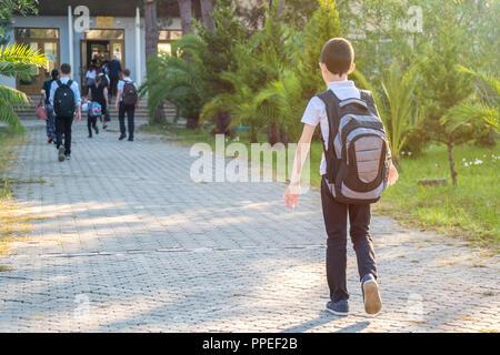 schoolboy in uniform goes to school, education. - Stock Photo