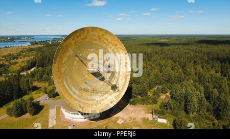 Radio astronomy observatory located in the forest. Aerial view Giant radio telescop, Large satellite dish.drone footage. - Stock Photo