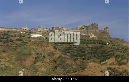 Syria. Baniyas. Margat castle, also known as Marqab from the Arabic Qalaat al-Marqab. It was a Crusader fortress and one of the major strongholds of the Knights Hospitaller. Built in 1062. - Stock Photo